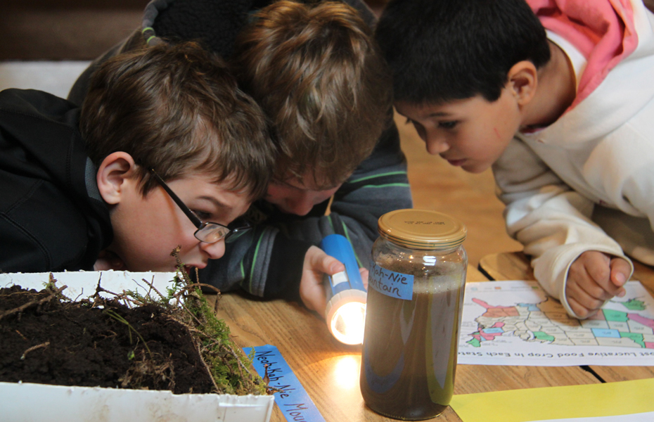 Kids looking at soils education